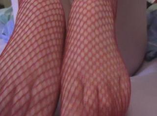 Privatporno: Fotze Fingern mit Hilfe von Netzstrümpfen