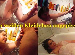 """Vorschaubild vom Privatporno mit dem Titel """"Im weißen Kleidchen angepisst"""""""